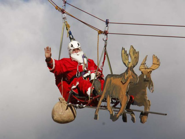 Santa Claus Flying Above Roofs of Makarska