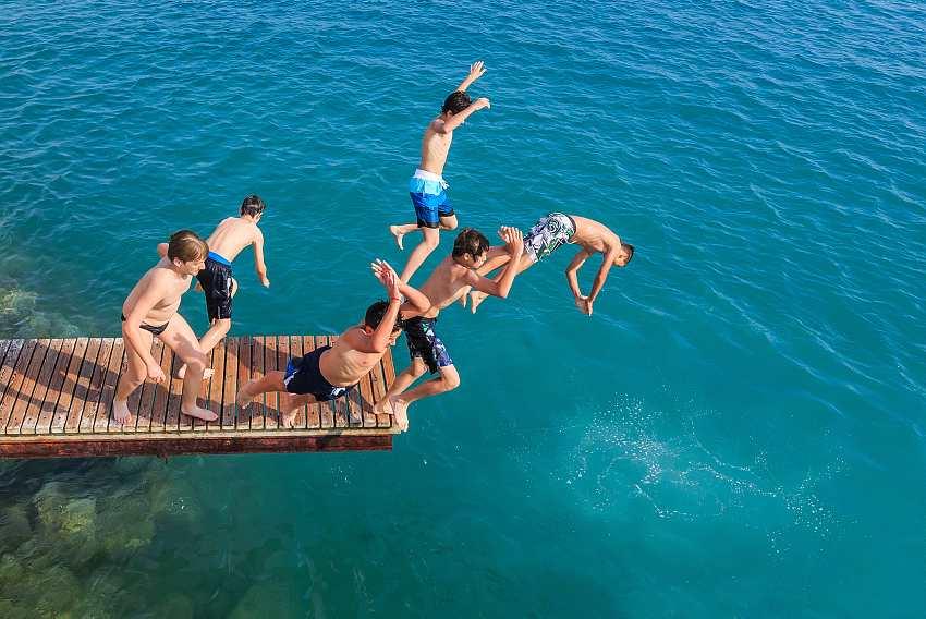 Children jumping in sea